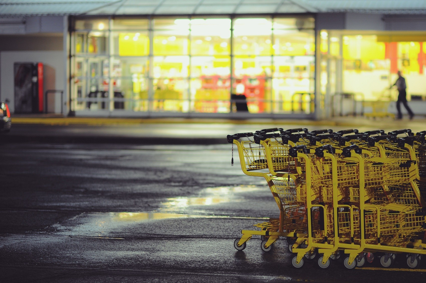 Empty shopping carts in front of superstore